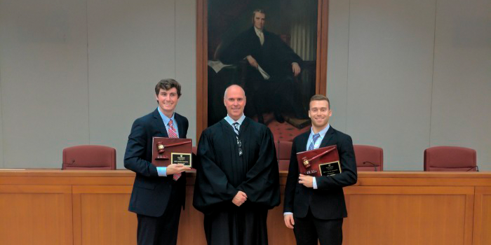 Photo of students with trial judge