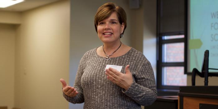 Professor Laura Graham speaking to faculty