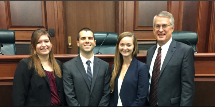 Photo of Kelsey Mellan (JD '18), Alex Teixeira (JD '18), Emily Lagan (JD '18) and Professor John Korzen (JD '91).