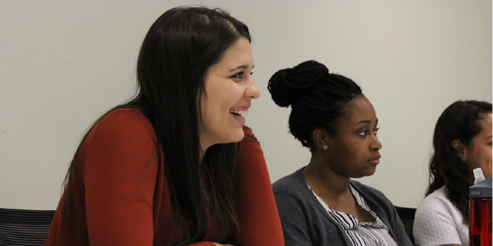 A photo of three members of the Women in Law student organization sitting at a table in the Worrell Professional Center.