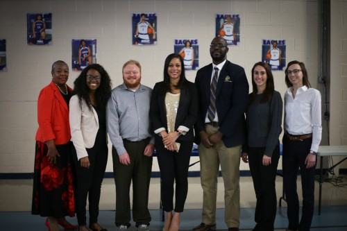 "Photo of Forsyth County District Court Judge Denise Hartsfield (JD '91) (far left) poses with law school students currently involved in the ""Know Your Rights' Pro Bono Project program."