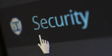 "Graphic of the word ""security"" with a computer mouse icon"