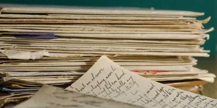 Photo of stack of handwritten letters