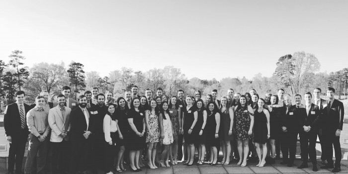 Black and white photo of 2018 Wake Forest Law Review members posing outside of the Forsyth Country Club.