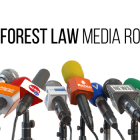 Photo of a group of microphones with the words Wake Forest Law Media Roundup over them