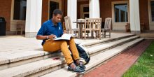 Photo of Tyler Potts (JD '19) studying outside the Worrell Professional Center.