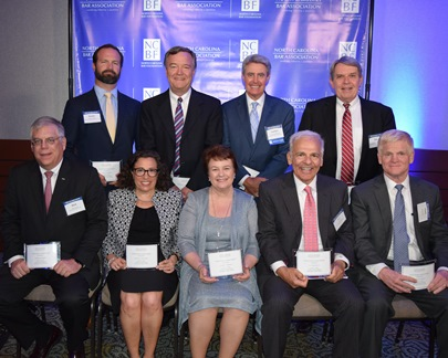 Photo of 2018 NCBA Citizen Lawyer Award winners posing and holding their awards