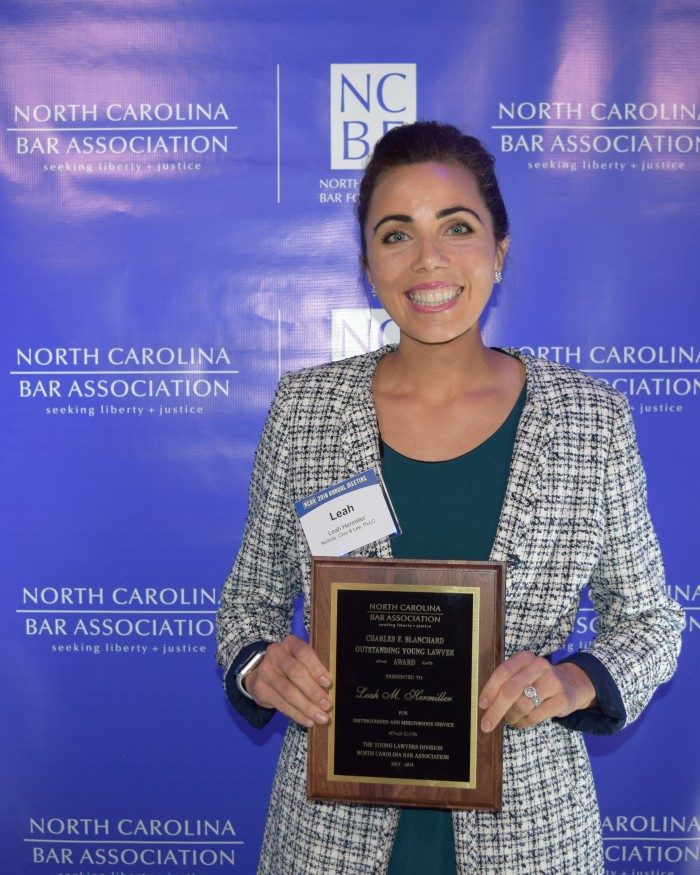Photo of Leah Hermiller (JD '14) holding plaque