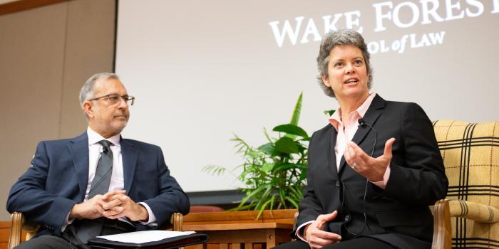 Kim Stevens talking at event next to Mark Rabil