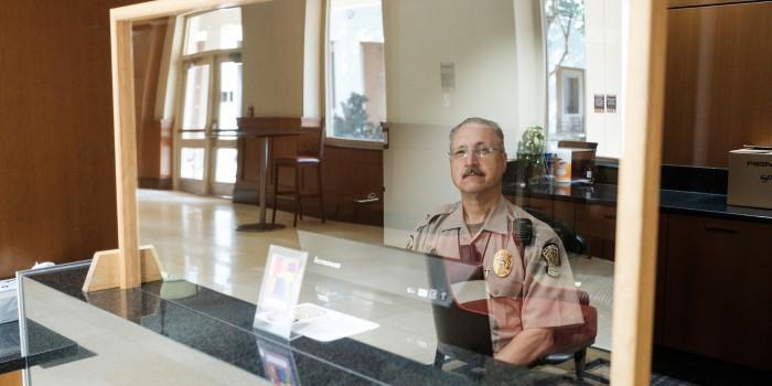 Officer John Long sits inside Wake Forest Law