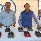 Stephen Hawthornthwaite (left), the co-founder, CEO, and chairman of Rothy's, showcases the company's line of shoes at a farmers market pop-up. (Photo courtesy of Rothy's)