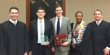 Group photo of Mike Stephens (JD '18) and Malcolm Boyd (JD '18) posing with their awards and judges Richard Dietz (JD '02), Denise Hartsfield (JD '91) and Eric Morgan following the 45th annual George K. Walker Moot Court Competition