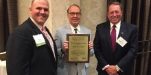 Photo of Bobby Griffin (JD '67) being inducted into the North Carolina Bar Association's General Practice Hall of Fame.